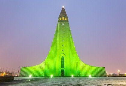 Large building lighted green