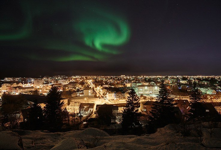 Northern lights over city