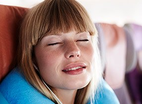 Relaxing woman with eyes closed traveling